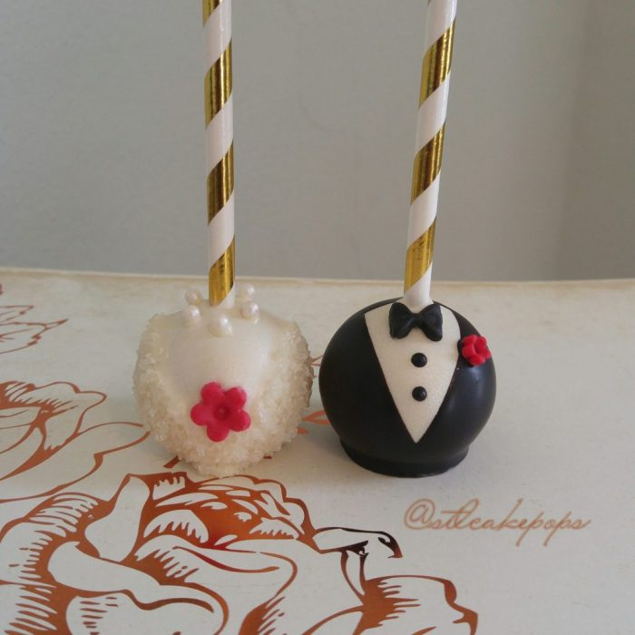 Bon Bon style Bride and groom cake pops with red flowers and stick out top