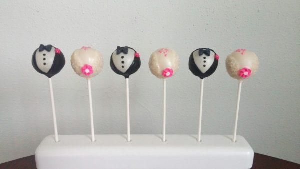 upright bride and groom cake pops; stick on bottom