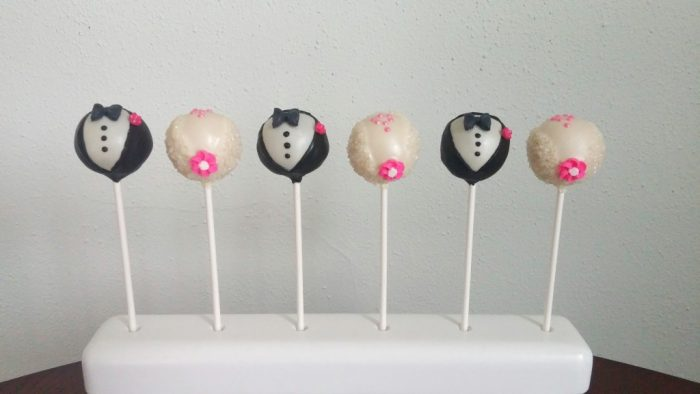 upright bride and groom cake pops; stick on bottom