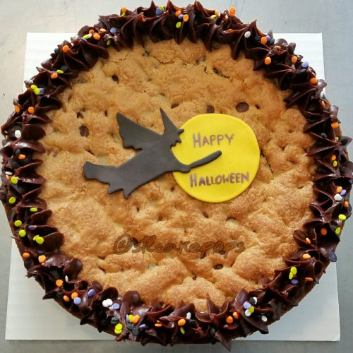 cookie cake with witch flying through the moon