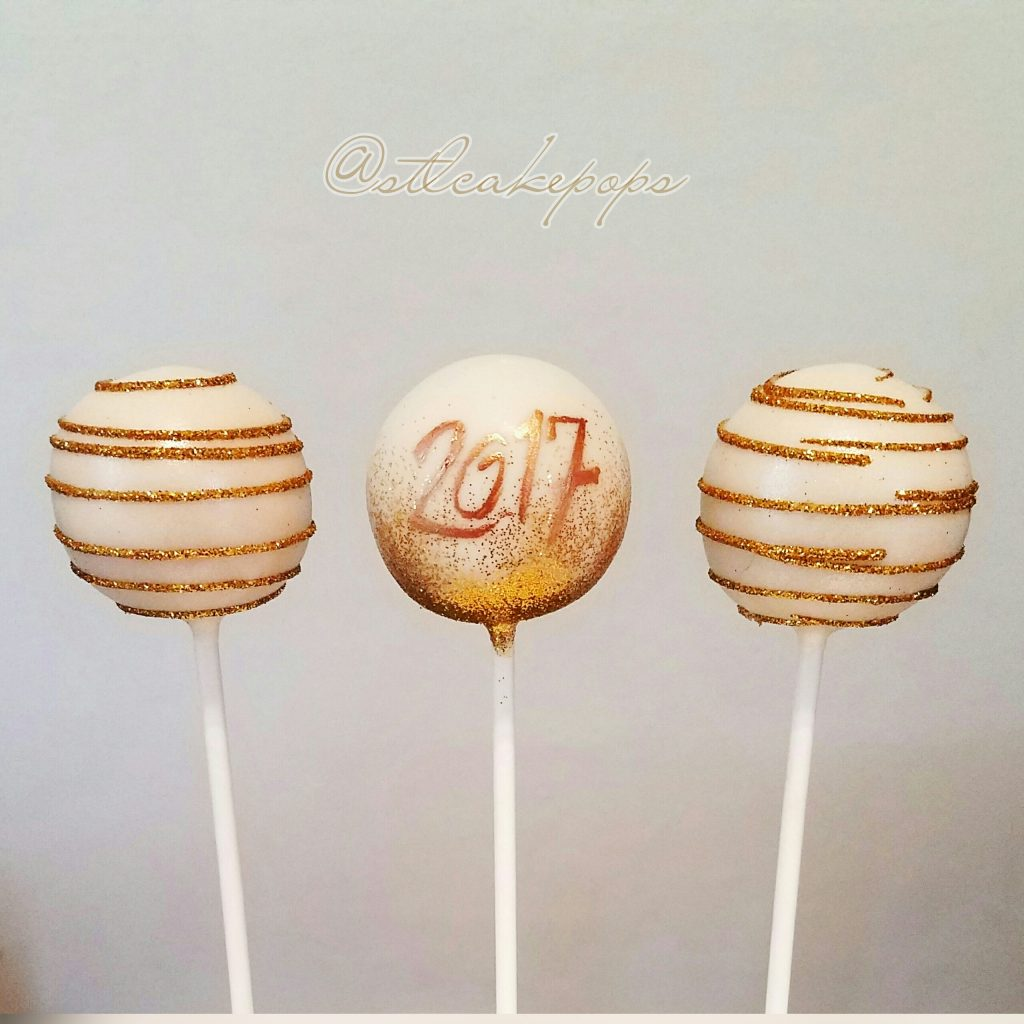 new year cake pops; gold swirl over white chocolate with year