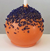 Orange cake pop with purple sugar sprinkles